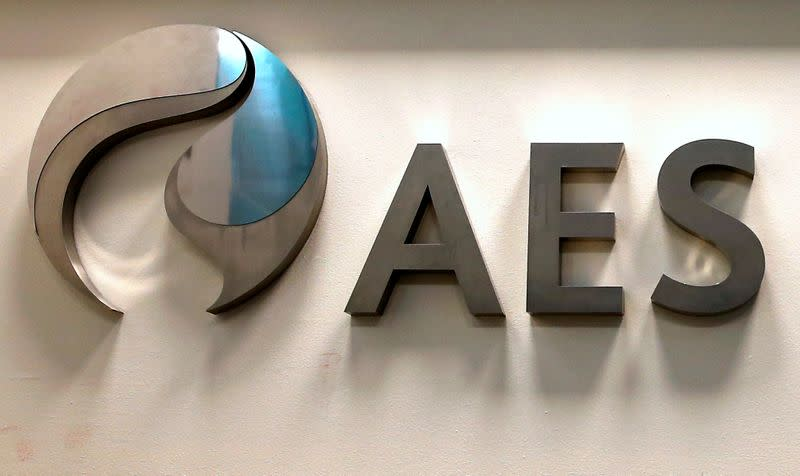 The logo of the multinational electric power company AES is seen at an office in Santiago