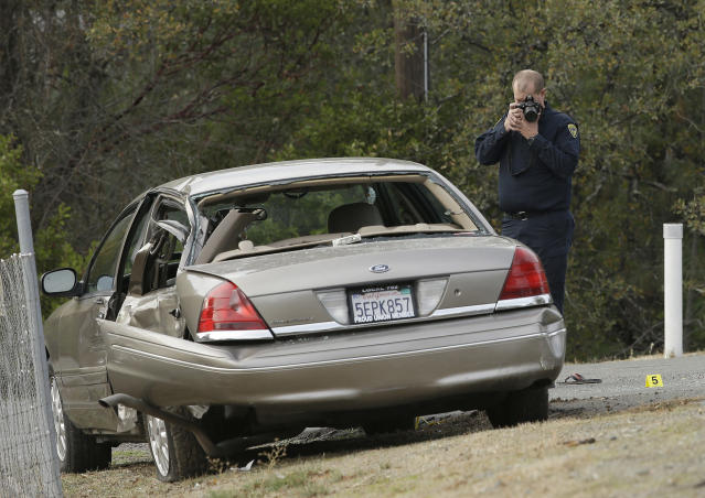 <p>A California Highway patrol officer photographs a vehicle involved in a deadly shooting rampage at the Rancho Tehama Reserve, near Corning, Calif., Nov. 14, 2017. (Photo: Rich Pedroncelli/AP) </p>