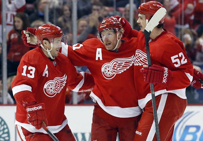 Wings end 6-game skid with 3-2 OT win over Flames