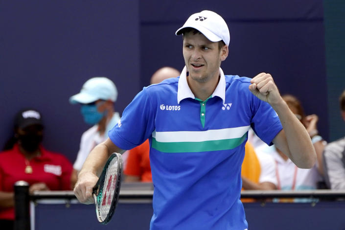 Hubert Hurkacz of Poland reacts after defeating Yannik Sinner of Italy during the finals of the Miami Open tennis tournament, Sunday, April 4, 2021, in Miami Gardens, Fla. Hurkacz won 7-6 (4), 6-4. (AP Photo/Lynne Sladky)