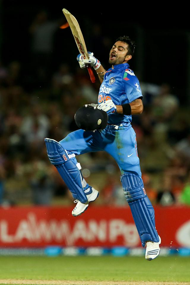 NAPIER, NEW ZEALAND - JANUARY 19:  Virat Kohli of India celebrates his century during the first One Day International match between New Zealand and India at McLean Park on January 19, 2014 in Napier, New Zealand.  (Photo by Hagen Hopkins/Getty Images)
