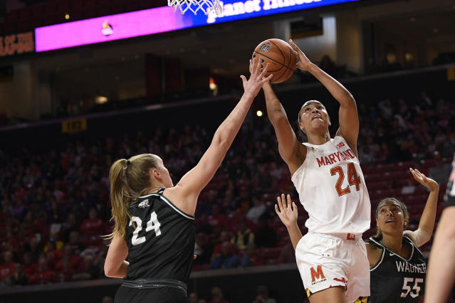 Maryland forward Stephanie Jones (24) goes to the basket as she is defended by Wagner forward Emilija Krista Grava (24) and forward Katrice Jackson (55) during the first half of an NCAA college basketball game, Tuesday, Nov. 5, 2019, in College Park, Md. (AP Photo/Nick Wass)