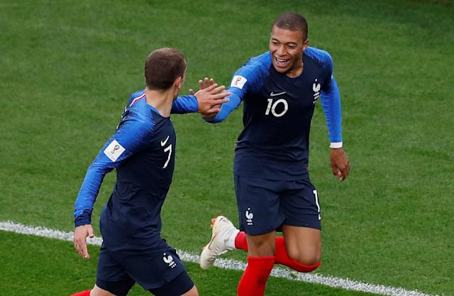 Soccer Football - World Cup - Group C - France vs Peru - Ekaterinburg Arena, Yekaterinburg, Russia - June 21, 2018 France's Kylian Mbappe celebrates scoring their first goal with Antoine Griezmann REUTERS/Andrew Couldridge