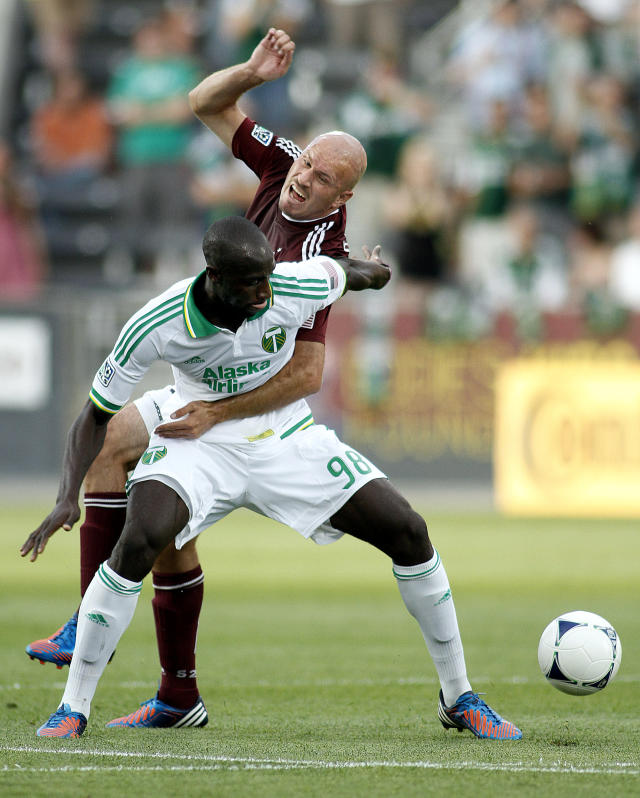 COMMERCE CITY, CO - JUNE 30: Conor Casey #9 of the Colorado Rapids gets tangled up with Mamadou Danso #98 of the Portland Timbers as they battle for control of a loose ball during their game at Dick's Sporting Goods Park June 30, 2012 in Commerce City, Colorado. (Photo by Marc Piscotty/Getty Images)