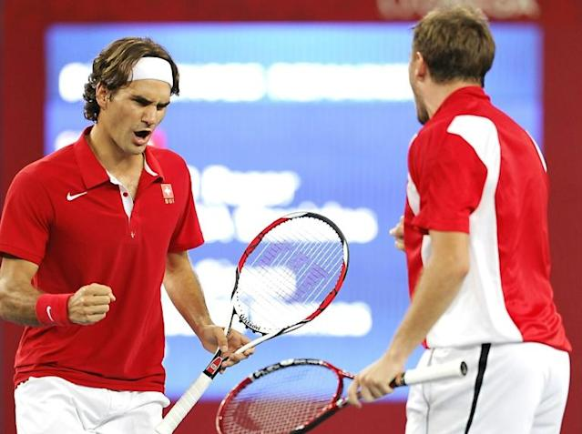 Way back when: Roger Federer and Stan Wawrinka celebrate after winning Olympic gold in the men's doubles in 2008 at Beijing (AFP Photo/PHILIPPE HUGUEN)