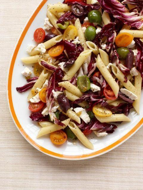 """<p>Bring the Mediterranean to your back yard with this festive, easy blend of briny olives, sweet tomatoes, salty feta, and peppery radicchio. </p><p><strong><a href=""""https://www.countryliving.com/food-drinks/recipes/a33263/sicilian-pasta-salad-recipe-rbk0412/"""" rel=""""nofollow noopener"""" target=""""_blank"""" data-ylk=""""slk:Get the recipe"""" class=""""link rapid-noclick-resp"""">Get the recipe</a>.</strong> </p>"""