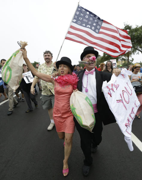 Demonstrators chant and walk during a protest march, Sunday, Aug. 26, 2012, in St Petersburg, Fla. Hundreds of protestors gathered a park in downtown St. Petersburg to march in demonstration against the Republican National Convention. (AP Photo/Patrick Semansky)