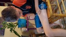 Atticus Simis, 12, gives himself an insulin injection, in Gardnerville
