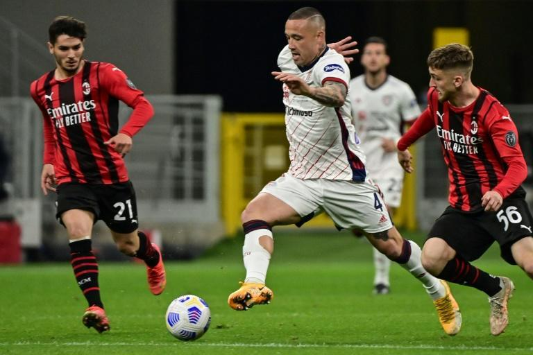 Cagliari snatched a point at AC Milan.