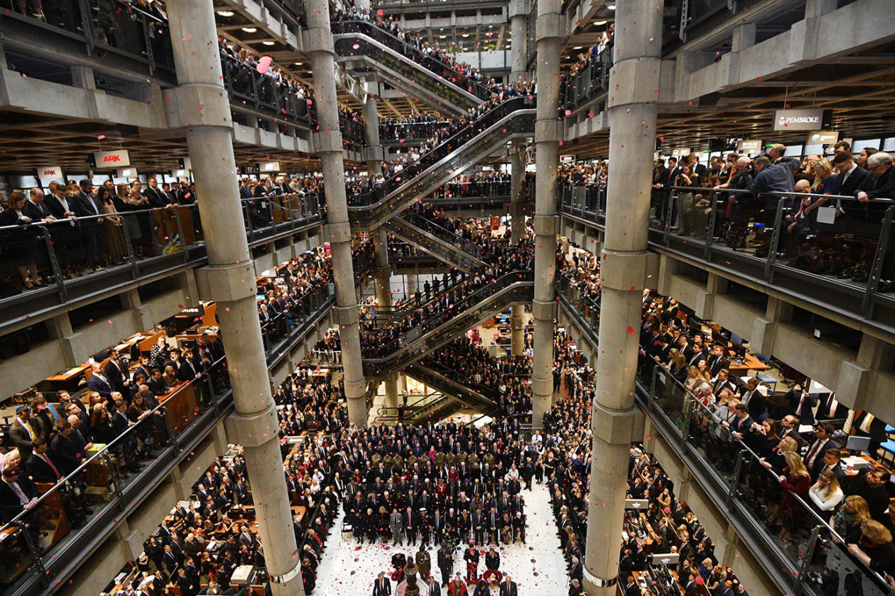 <p>Staff line the atrium as poppies fall during their annual Remembrance Day Armistice commemoration service at Lloyds of London, in the City of London, Britain on Nov. 9 2018. The 11 Nov. 11 marks the 100th anniversary of the First World War Armistice with services taking place across the world to commemorate the occasion. (Photo from EPA/Neil Hall) </p>