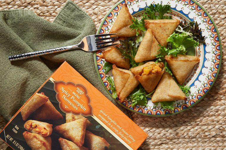 <p>Don't be fooled by the golden flaky pastry exterior. <strong>This Indian-inspired appetizer features garam masala, cumin, and fennel seeds with paneer cheese and chunks of pumpkin.</strong> A great pumpkin-flavored finger-food option that guests are sure to love. Four pieces only have 170 calories, 30 grams of carbs, and boast 6 grams of protein.</p><p><strong><em>RD Pick</em></strong><br></p>