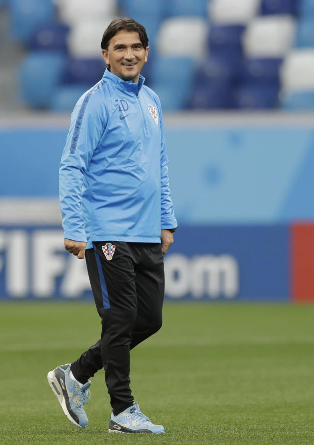 Croatia head coach Zlatko Dalic smiles as he walks on the pitch during official training on the eve of the group D match between Croatia and Argentina in the Nizhny Novgorod stadium in Nizhny Novgorod, Russia, Wednesday, June 20, 2018. (AP Photo/Petr David Josek)