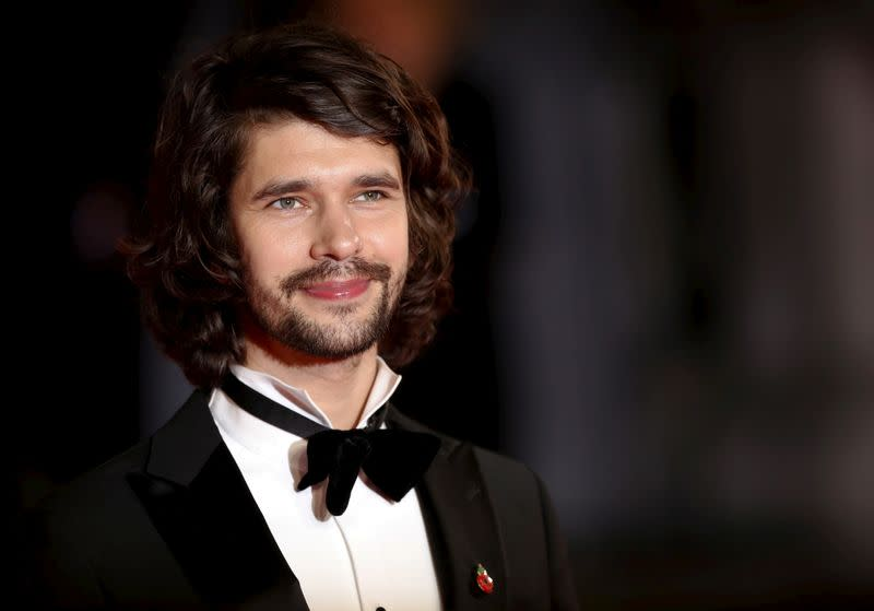 """FILE PHOTO: Ben Whishaw poses for photographers on the red carpet at the world premiere of the new James Bond 007 film """"Spectre"""" at the Royal Albert Hall in London"""