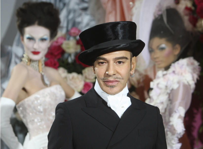 FILE - In this Jan. 25, 2010 file photo, fashion designer John Galliano poses at the end of the presentation of the Dior Haute Couture spring/summer 2010 fashion collection in Paris. Parsons The New School of Design in New York City said in a statement Wednesday May 8, 2013 it has canceled a four-day workshop by the controversial  fashion designer because the two sides can't reach consensus on the conditions of the workshop. (AP Photo/Jacques Brinon, file)