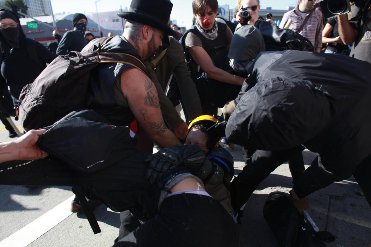 OAKLAND, CA - NOVEMBER 2:  Demonstrators clash during an Occupy demonstration November 2, 2011 in Oakland, California. The group called for a general strike Wednesday, and planned to march on the city's port later in the day.(Photo by Eric Thayer/Getty Images)