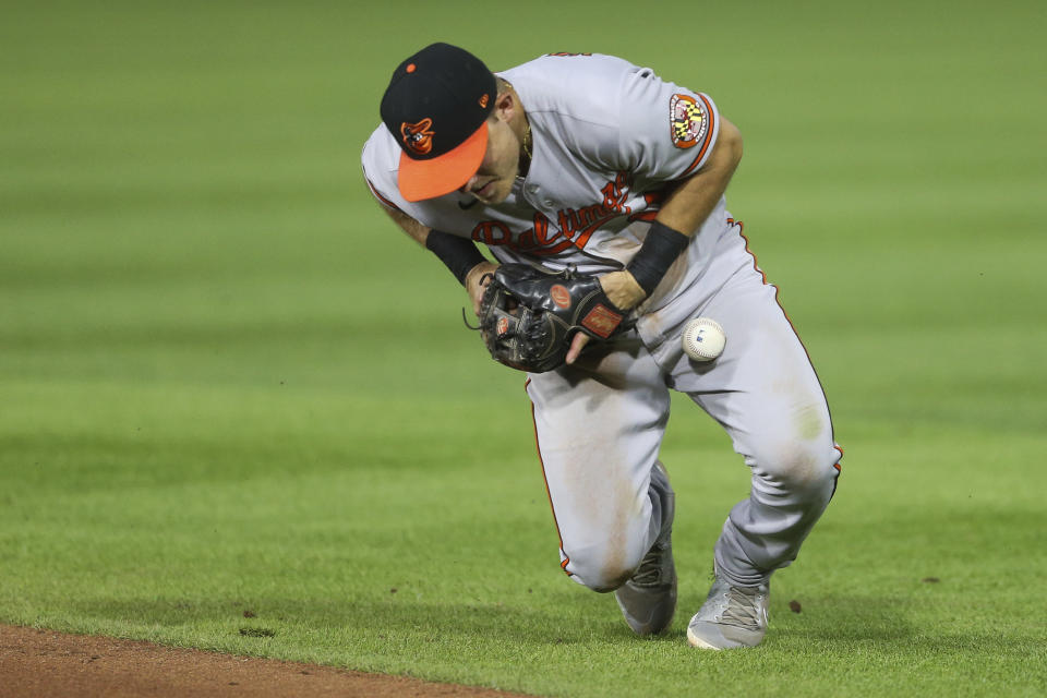 Baltimore Orioles second baseman Pat Valaika bobbles a ground ball by Toronto Blue Jays' Joe Panik, but still records the out, during the fifth inning of the baseball game in Buffalo, N.Y., Thursday, June 24, 2021. (AP Photo/Joshua Bessex)