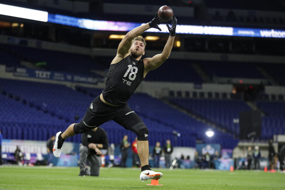 South Florida tight end Mitchell Wilcox runs a drill at the NFL football scouting combine. (AP Photo/Michael Conroy)