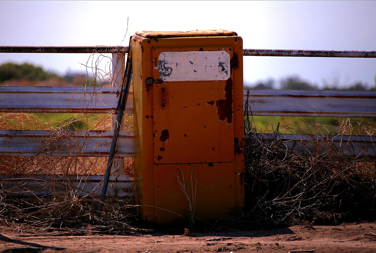<p>An old refrigerator haa been repurposed as a mailbox on a road in the outskirts of Walgett township, northwest of Sydney, Australia. (Photo: David Gray/Reuters) </p>