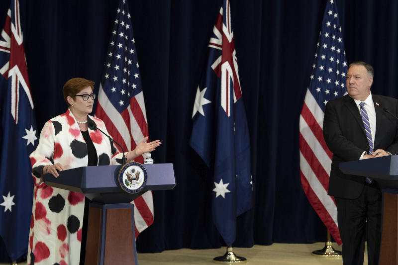 Secretary of State Mike Pompeo listens while Australia's Foreign Minister Marise Payne speaks during a news conference in Washington on Tuesday (local time). Source: AAP