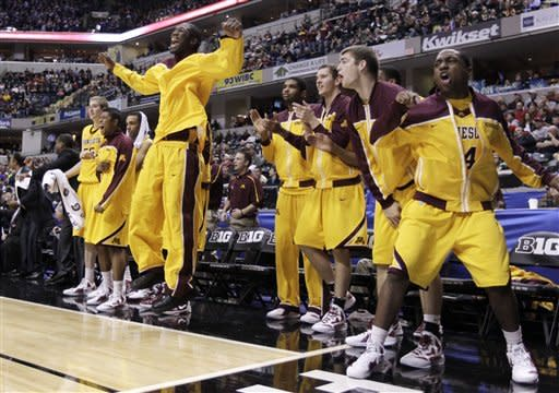 Players on Minnesota bench react in the overtime of an NCAA college basketball game against Northwestern at the Big Ten Conference tournament in Indianapolis, Thursday, March. 8, 2012. Minnesota won 75-68 in overtime. (AP Photo/Michael Conroy)