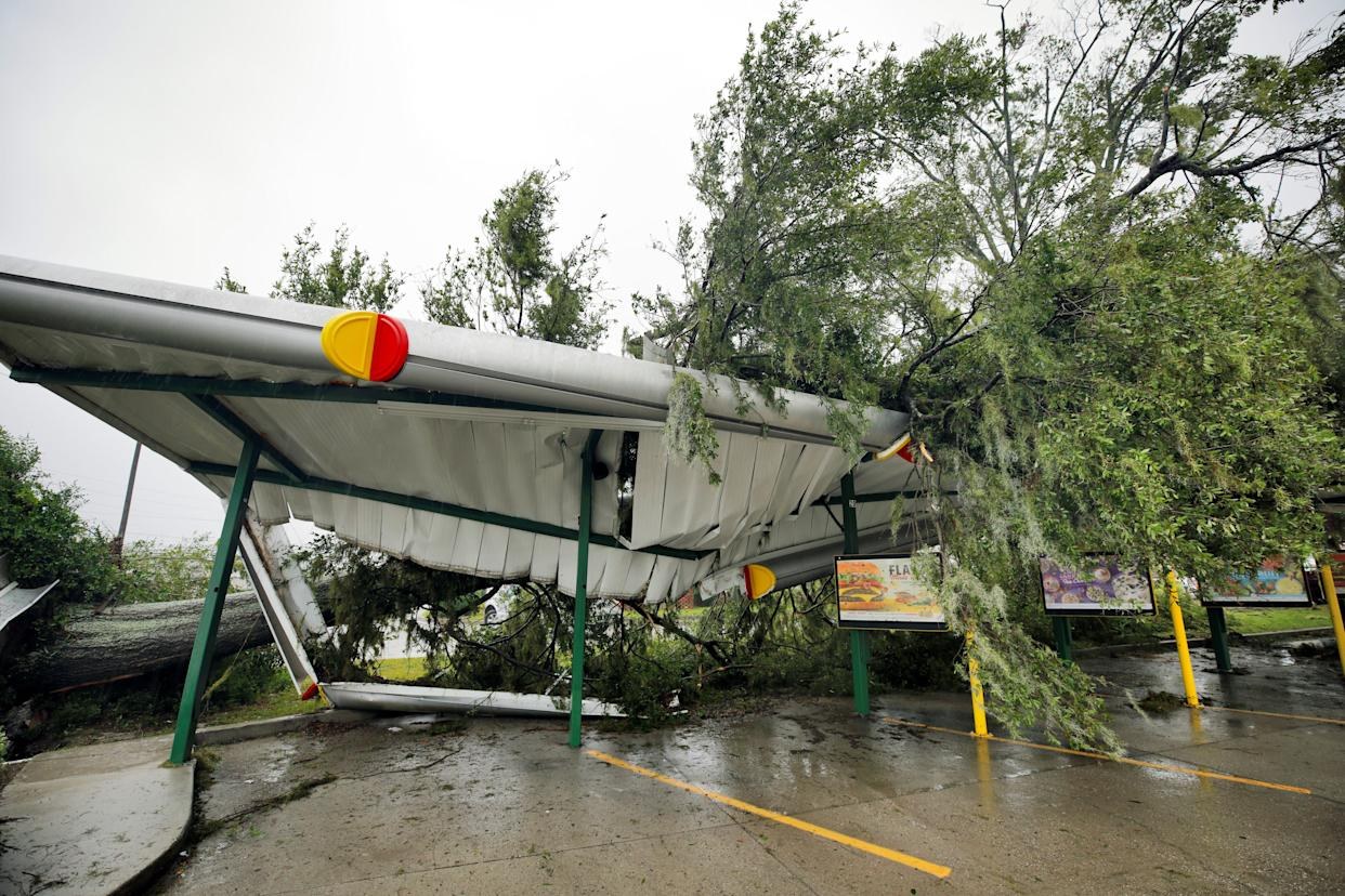 A fallen tree lies atop the crushed roof of a fast food restaurant after the arrival of Hurricane Florence in Wilmington, North Carolina on Friday.