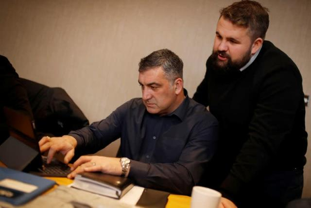 Football agent Kiko Rodriguez and associate Nick Cassidy of DRN Sports Management discuss potential transfer deals on transfer deadline day at their offices in Burnley