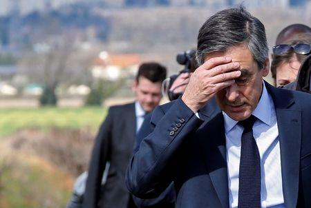 Francois Fillon, former French prime minister, member of the Republicans political party and 2017 presidential election candidate of the French centre-right walks in vineyards before a meeting with winegrowers in Nimes