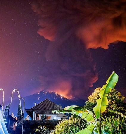 Thick smoke and glow from lava are seen as Mount Agung volcano erupts in Karangasem Regency, Bali, Indonesia