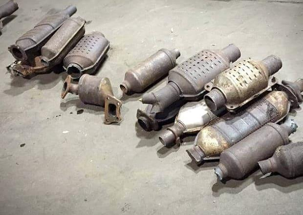 These catalytic converters were recovered by Cape Breton Regional Police during an investigation. Police in Guelph and Waterloo region say thefts of the converters are on the rise. (Submitted by Cape Breton Regional Police - image credit)