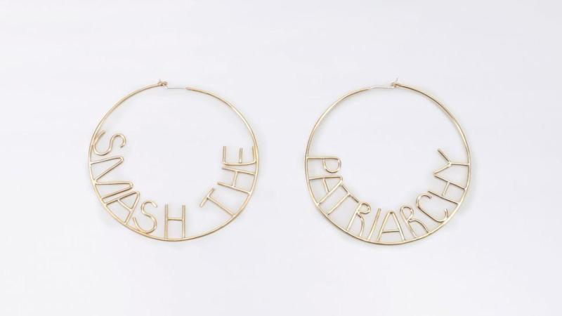"""Get them <a href=""""https://www.wildfang.com/smash-the-patriarchy-hoop-earrings119996.html"""" target=""""_blank"""">here</a>."""
