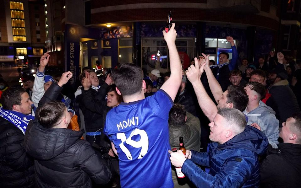 Chelsea fans celebrate their team's victory over Real Madrid - PA