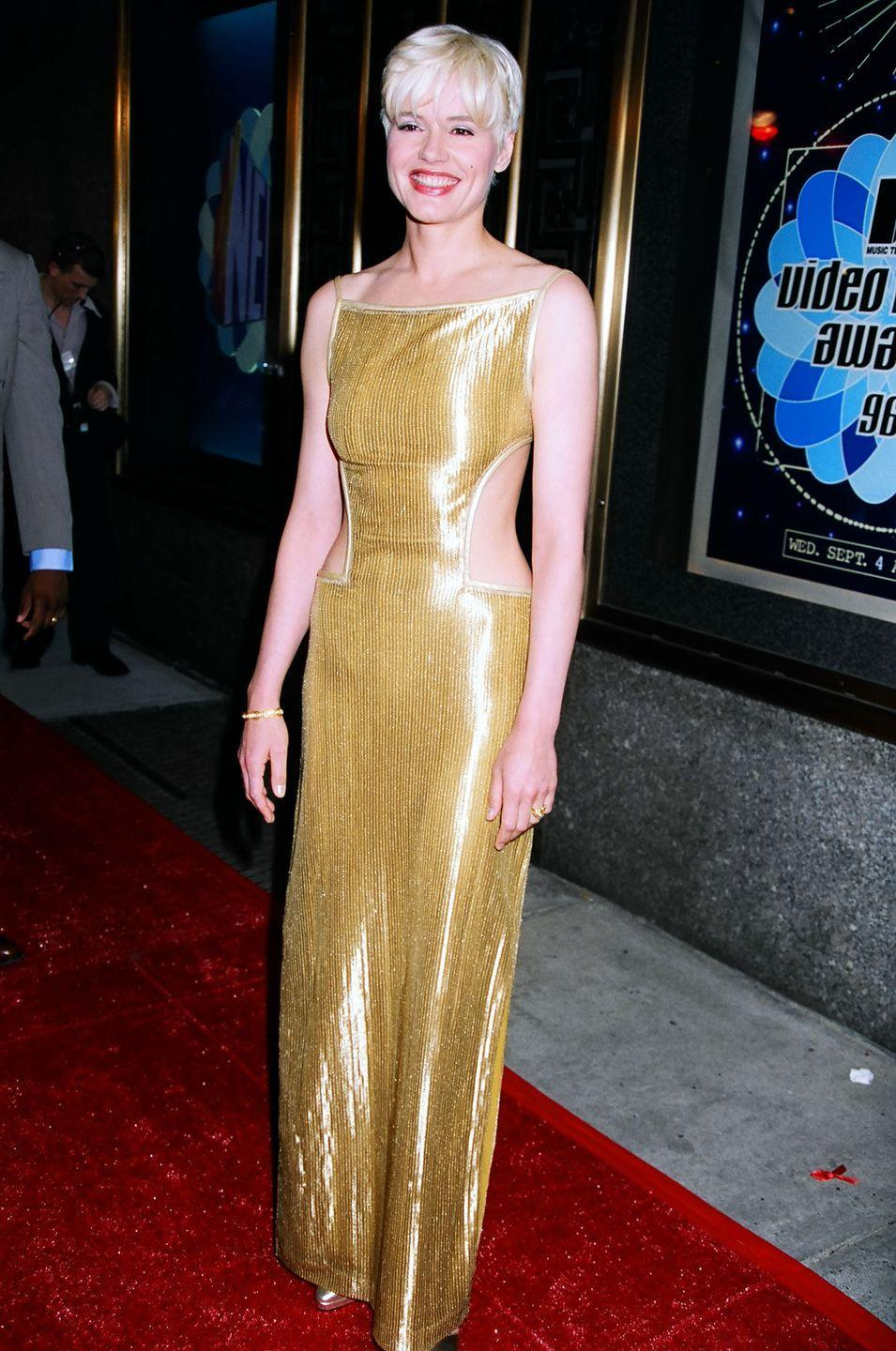 <p>Geena Davis turned heads in this gold dress, which featured a completely backless design.</p>