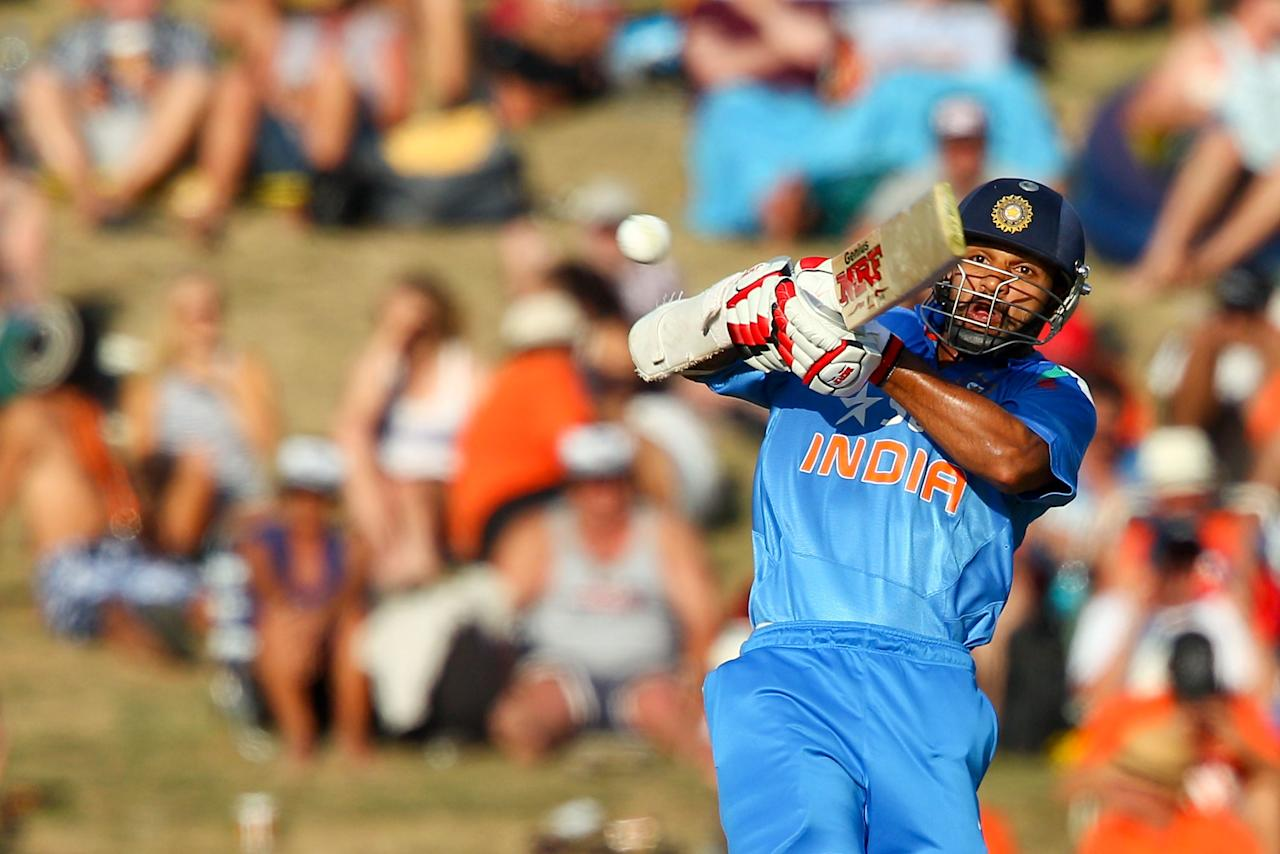 NAPIER, NEW ZEALAND - JANUARY 19:  Shikhar Dhawan of India bats during the first One Day International match between New Zealand and India at McLean Park on January 19, 2014 in Napier, New Zealand.  (Photo by Hagen Hopkins/Getty Images)