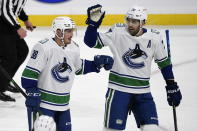 Vancouver Canucks' Nate Schmindt (88) celebrates his goal against the Winnipeg Jets with Brandon Sutter (20) during first period NHL hockey action in Winnipeg, Manitoba on Tuesday March 1, 2021. (Fred Greenslade/The Canadian Press via AP)