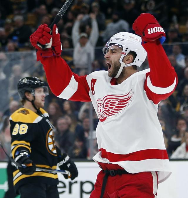 Detroit Red Wings' Frans Nielsen celebrates his go-ahead goal during the third period of an NHL hockey game against the Boston Bruins in Boston, Saturday, Dec. 1, 2018. (AP Photo/Michael Dwyer)