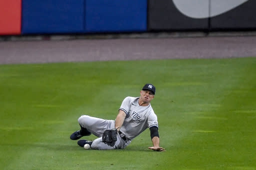 New York Yankees left fielder Brett Gardner fields a double by Toronto Blue Jays' Cavan Biggio during the first inning of a baseball game in Buffalo, N.Y., Monday, Sept. 7, 2020. (AP Photo/Adrian Kraus)