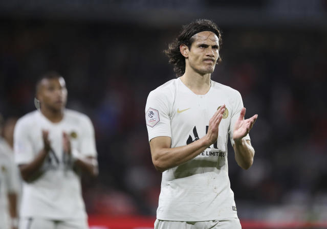 PSG's Edinson Cavani applauds spectators after the French League One soccer match between Rennes and Paris Saint Germain, in Rennes, Sunday, Aug. 18, 2019. Rennes won the match 2-1. (AP Photo/David Vincent)