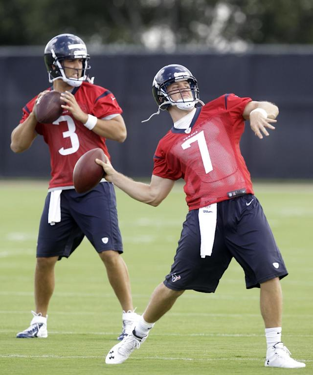 Houston Texans quarterbacks Case Keenum (7), and Tom Savage (3), throw during NFL football minicamp, Wednesday, June 18, 2014, in Houston. (AP Photo/Patric Schneider)