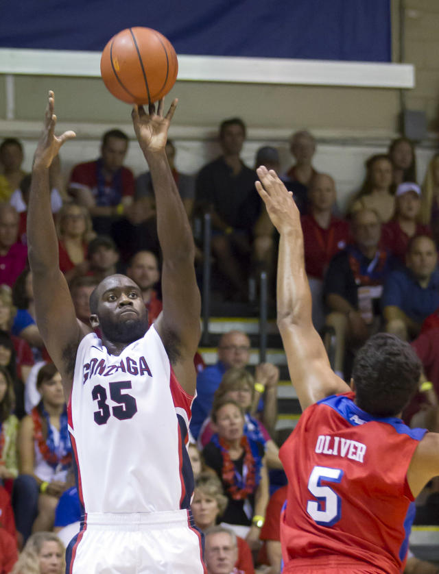 Gonzaga center Sam Dower (35) takes a 3-point shot over Dayton forward Devin Oliver (5) in the first half of an NCAA college basketball game at the Maui Invitational on Monday, Nov. 25, 2013, in Lahaina, Hawaii. (AP Photo/Eugene Tanner)