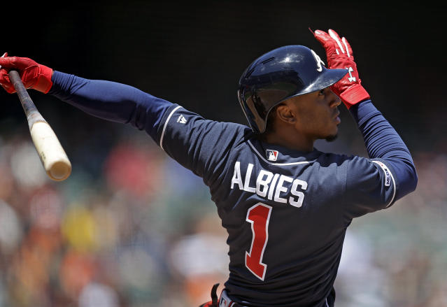 Atlanta Braves' Ozzie Albies swings for an RBI single off San Francisco Giants' Madison Bumgarner in the fourth inning of a baseball game Thursday, May 23, 2019, in San Francisco. (AP Photo/Ben Margot)