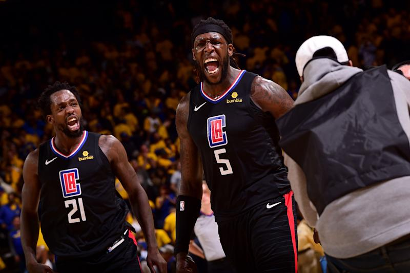 OAKLAND, CA - APRIL 15: Patrick Beverley #21 and Montrezl Harrell #5 of the LA Clippers react during a game against the Golden State Warriors during Game Two of Round One of the 2019 NBA Playoffs on April 15, 2019 at ORACLE Arena in Oakland, California. NOTE TO USER: User expressly acknowledges and agrees that, by downloading and or using this photograph, user is consenting to the terms and conditions of Getty Images License Agreement. Mandatory Copyright Notice: Copyright 2019 NBAE (Photo by Noah Graham/NBAE via Getty Images)