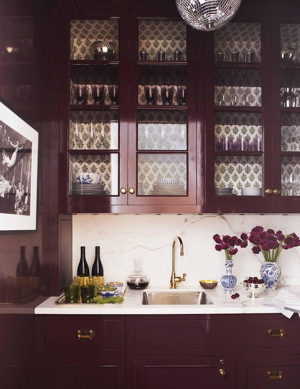 """<p>In this butler's pantry designed by <a href=""""http://www.ashleywhittakerdesign.com/"""" rel=""""nofollow noopener"""" target=""""_blank"""" data-ylk=""""slk:Ashley Whittaker"""" class=""""link rapid-noclick-resp"""">Ashley Whittaker</a>, a disco ball adds sparkle to walls and millwork lacquered in a custom <a href=""""https://www.finepaintsofeurope.com/"""" rel=""""nofollow noopener"""" target=""""_blank"""" data-ylk=""""slk:Fine Paints of Europe"""" class=""""link rapid-noclick-resp"""">Fine Paints of Europe</a> color. The cabinets are backed in a <a href=""""http://www.murielbrandolini.com/"""" rel=""""nofollow noopener"""" target=""""_blank"""" data-ylk=""""slk:Muriel Brandolini"""" class=""""link rapid-noclick-resp"""">Muriel Brandolini</a> fabric. </p><p><a class=""""link rapid-noclick-resp"""" href=""""https://www.amazon.com/Porcelain-Bud-Vase-Blue-White/dp/B07BNVYQJK?tag=syn-yahoo-20&ascsubtag=%5Bartid%7C10069.g.28837805%5Bsrc%7Cyahoo-us"""" rel=""""nofollow noopener"""" target=""""_blank"""" data-ylk=""""slk:Find Similar Blue & White Bud Vases Here"""">Find Similar Blue & White Bud Vases Here</a></p>"""