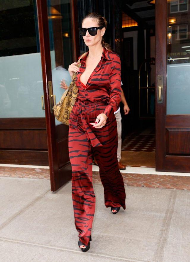 She styled the bold jumpsuit with platform pumps and oversized shades. (Photo: Getty Images)