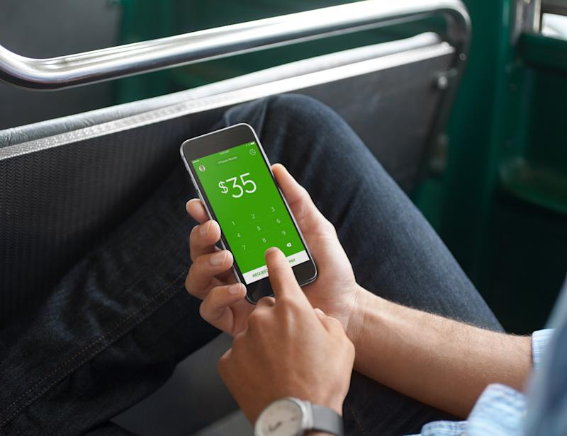 A person using Cash App on a smartphone