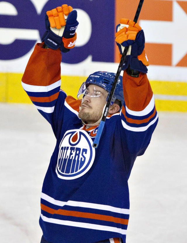Edmonton Oilers' Andrew Ference celebrates his overtime goal against the Anaheim Ducks during an NHL hockey game in Edmonton, Alberta, on Friday, March 28, 2014. Edmonton won 4-3. (AP Photo/The Canadian Press, Jason Franson)
