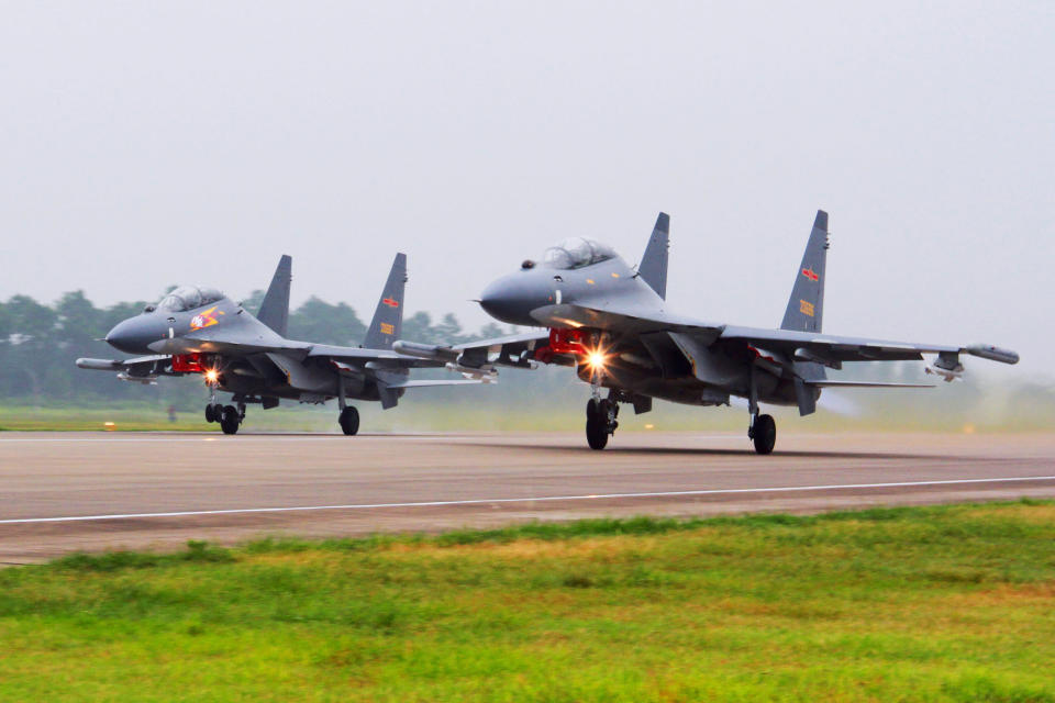 FILE - In this undated file photo released by China's Xinhua News Agency, two Chinese SU-30 fighter jets take off from an unspecified location to fly a patrol over the South China Sea. China flew more than 30 military planes, including SU-30 fighter jets, toward Taiwan on Saturday, Oct. 3, 2021, the second large display of force in as many days.(Jin Danhua/Xinhua via AP, File)