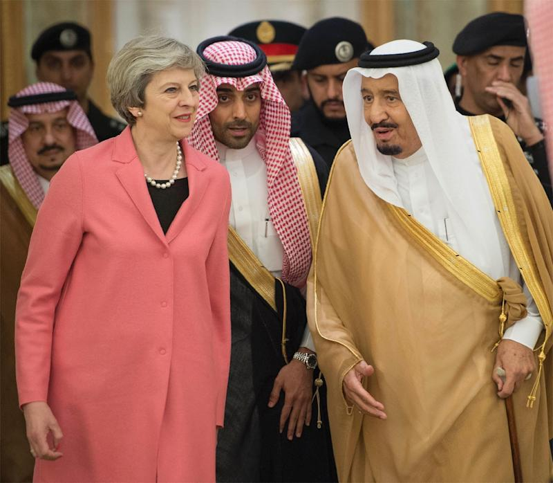 British PM Theresa May lands in Saudi Arabia without headscarf