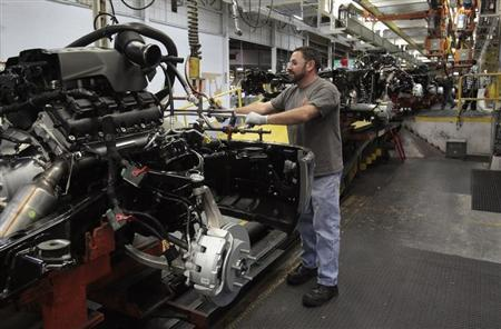 Chrysler assembly staff works on the chassis of a 2014 Dodge Ram pickup truck at the Warren Assembly Plant in Warren