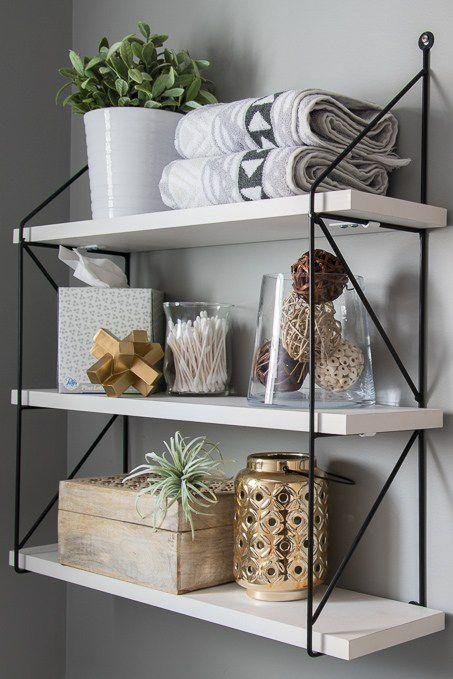 "<p>Obvious, but needs to be said. For a more modern vibe, skip the floating shelves and choose a shelving unit with iron hardware.</p><p>See more at <a rel=""nofollow"" href=""http://www.keystoinspiration.com/fresh-modern-powder-room-reveal/"">Keys To Inspiration</a>.</p>"