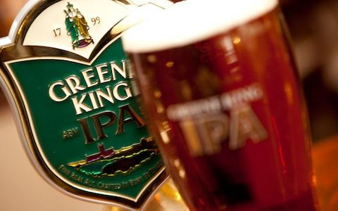 Greene King plc...A pint of Greene King IPA in a branded glass. - Credit: Newscast/Ally Carmichael